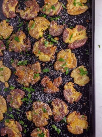 Crispy potatoes topped with garlic, parmesan cheese, and fresh parsley