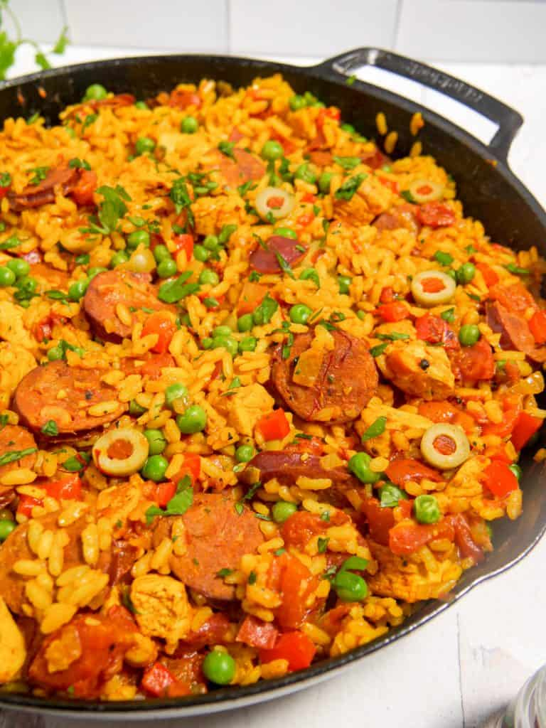 close up of paella in a cast iron pan