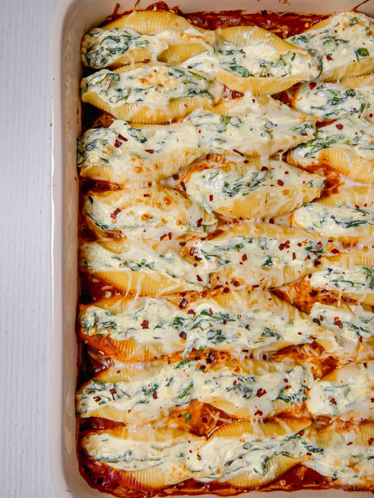 overhead shot of baking dish filled with red sauce and stuffed cheese pasta shells