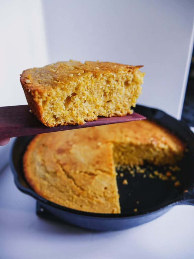 slice of cornbread out of the skillet