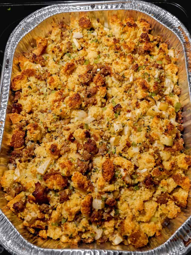overhead shot of a large platter of cornbread stuffing with sausage