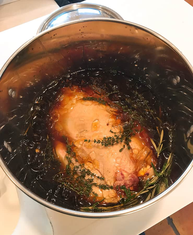 turkey submerged in large pot