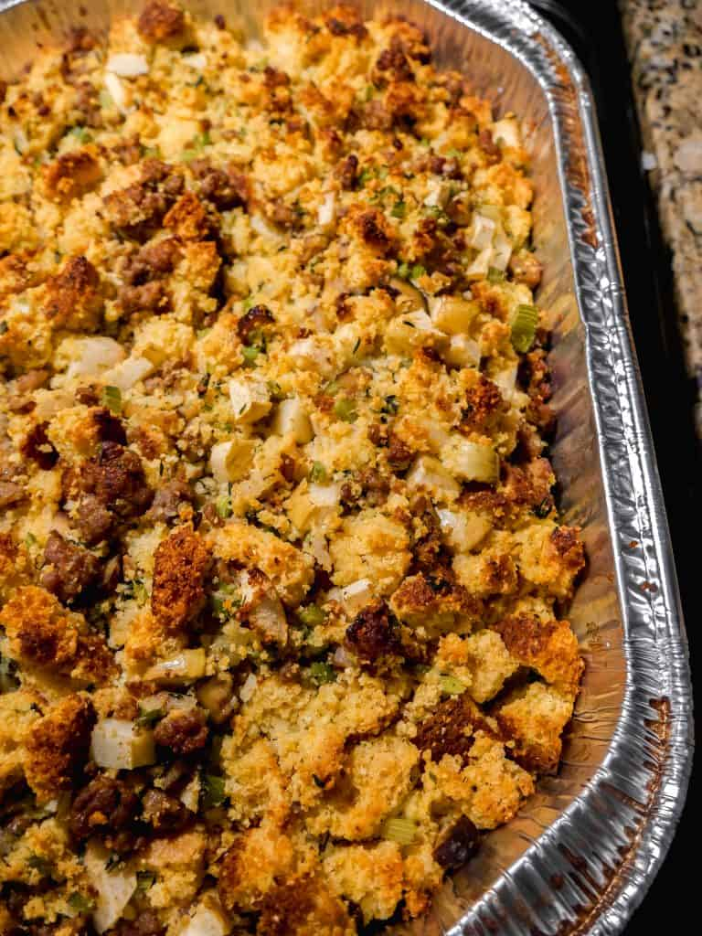 close up shot of cornbread stuffing in a large platter