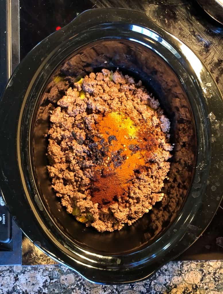 assembling slow cooker chili in the crockpot