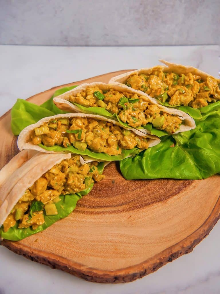curry chicken salad stuffed into pita pockets with lettuce