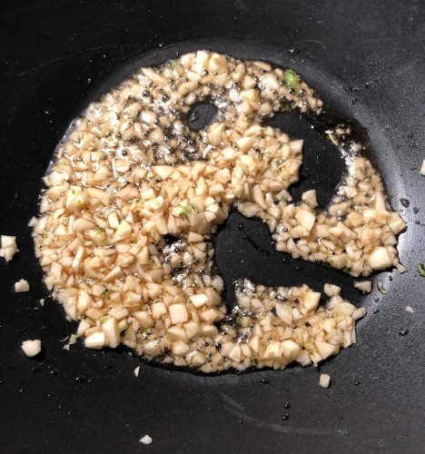 wok with minced garlic