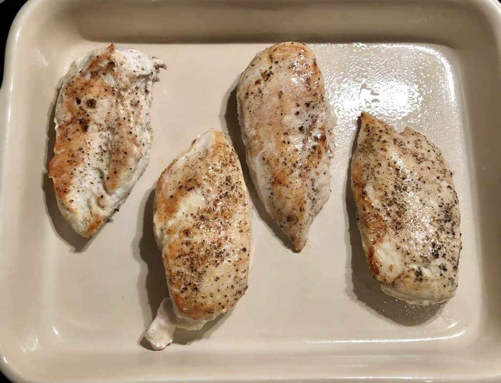 pan seared chicken breasts in a dish