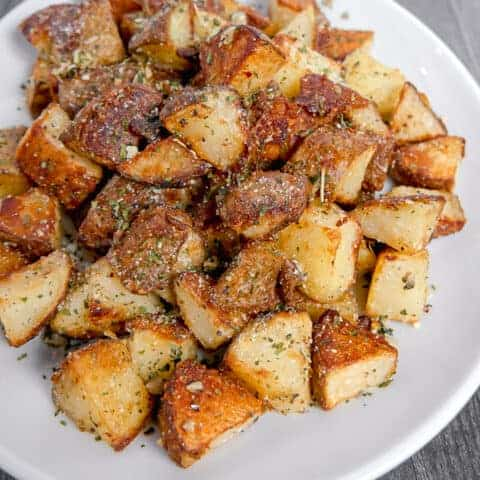 crispy roasted square potatoes on a white plate