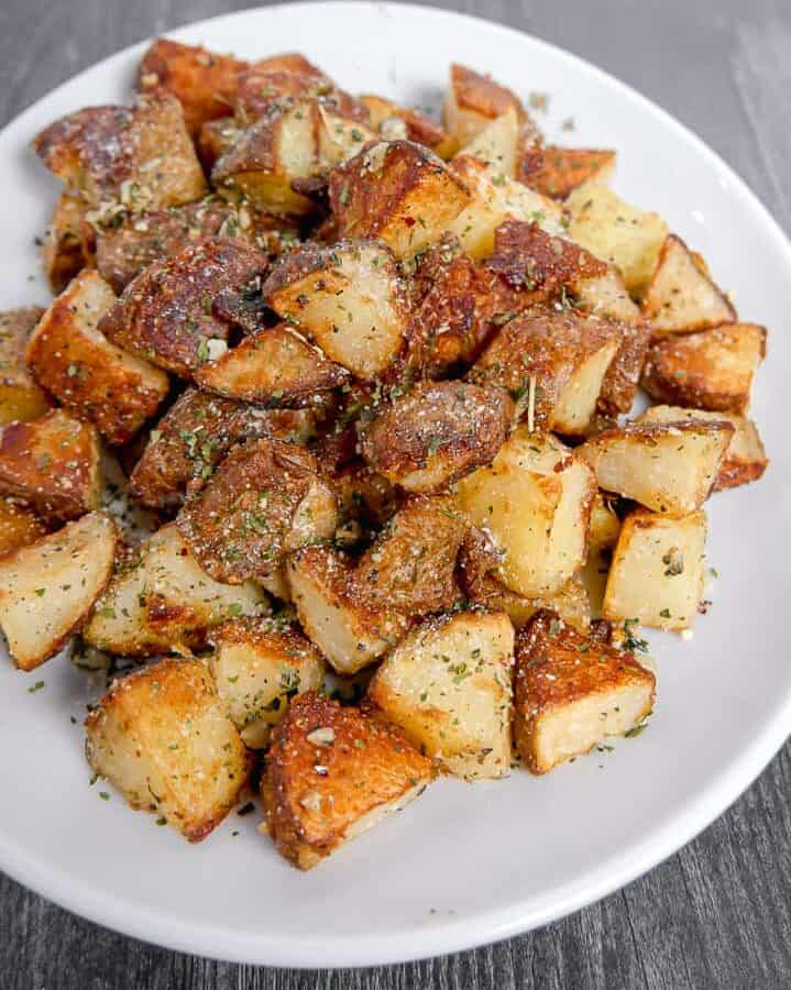 crispy roasted square potatoes on a white plate