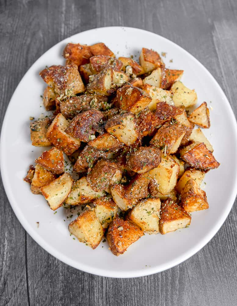 plate of cubed roasted potatoes on a white plate