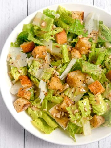 romain salad with croutons, parmesan cheese, and homemade vinaigrette