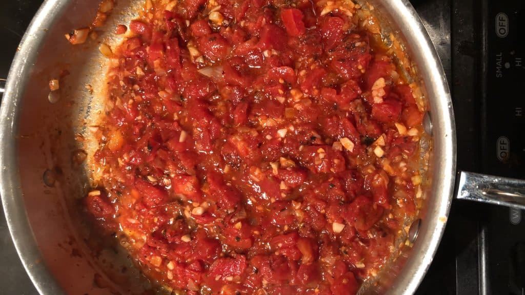 fire roasted tomatoes in a saute pan
