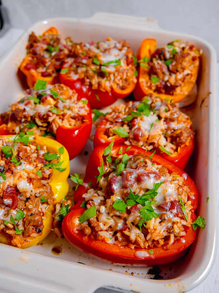 close up of red stuffed bell pepper in a baking dish
