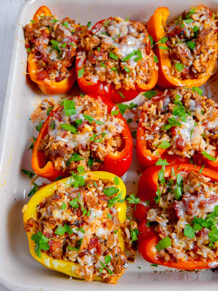 baking dish filled with sausage stuffed bell peppers