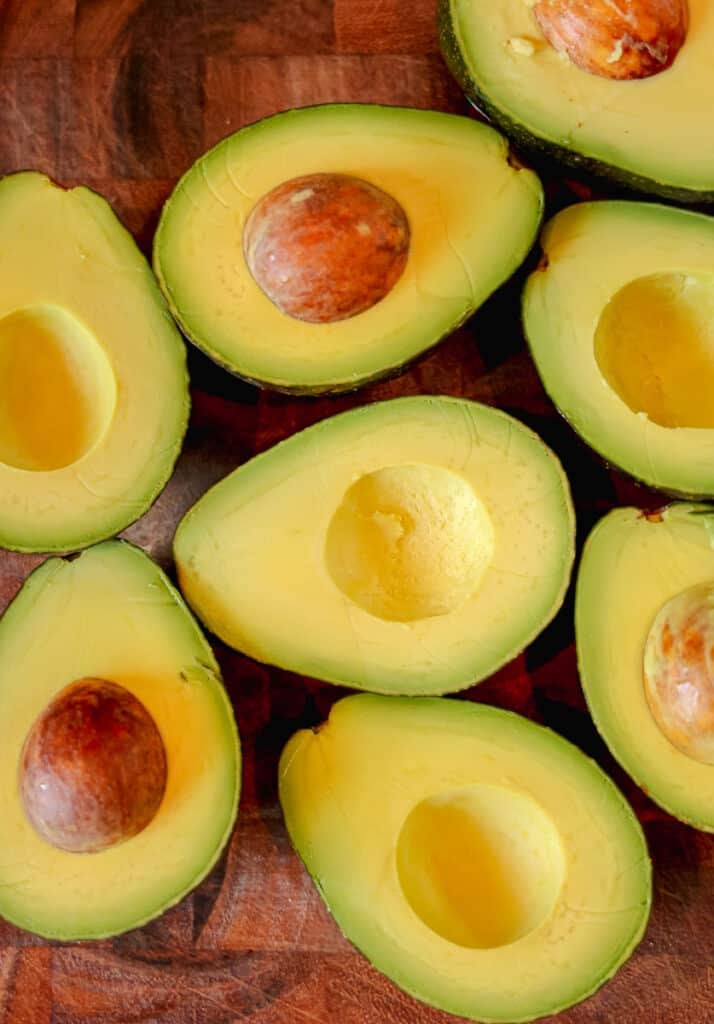 avocados cut open on cutting board
