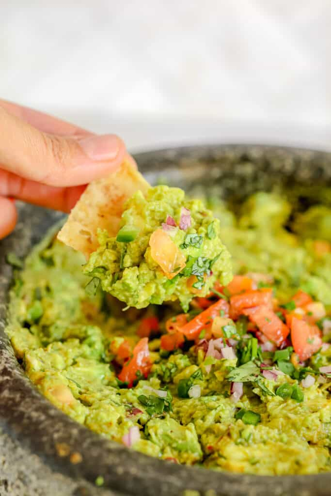 chip being dipped into guacmole
