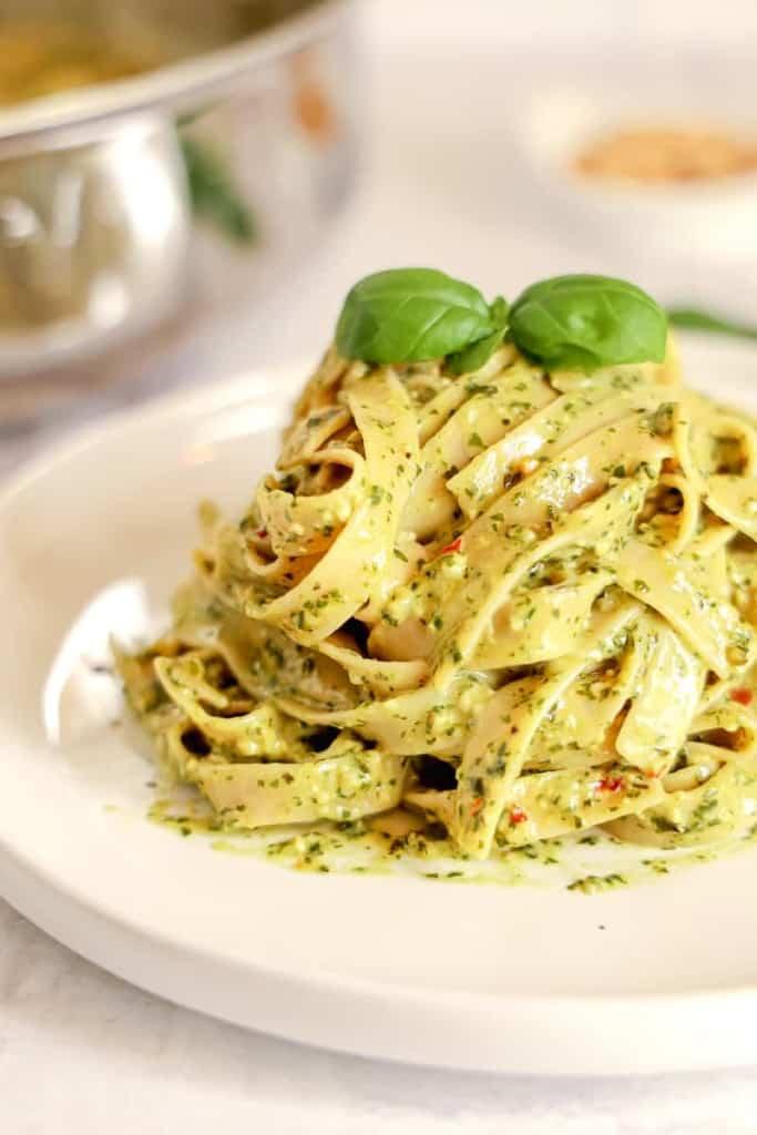 mound of pesto pasta on a plate