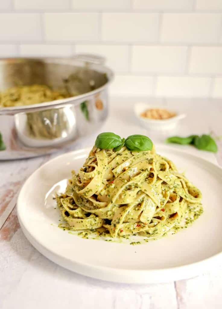 plate piled with creamy pesto pasta