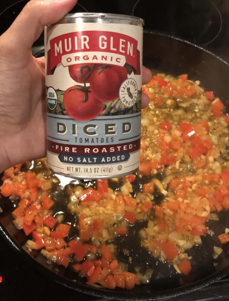 fire roasted diced tomato can with skillet in the background