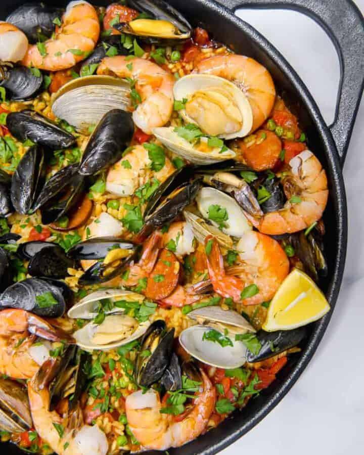 close up of seafood chorizo paella in a cast iron skillet