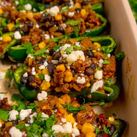 zoomed in stuffed poblano pepper with ground beef, beans, and corn