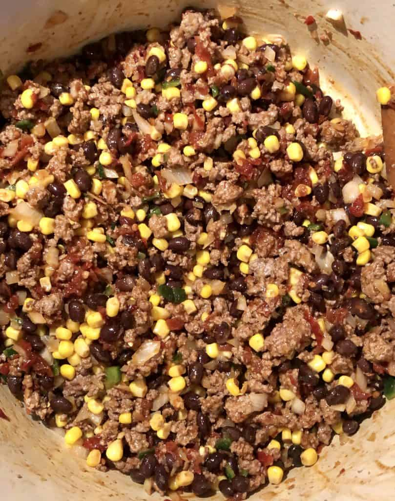 dutch oven with ground beef, corn, and black beans