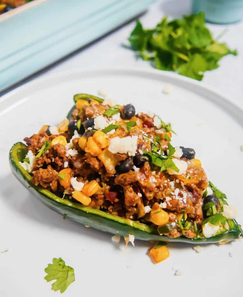 close up of poblano pepper stuffed with ground beef and corn and black beans