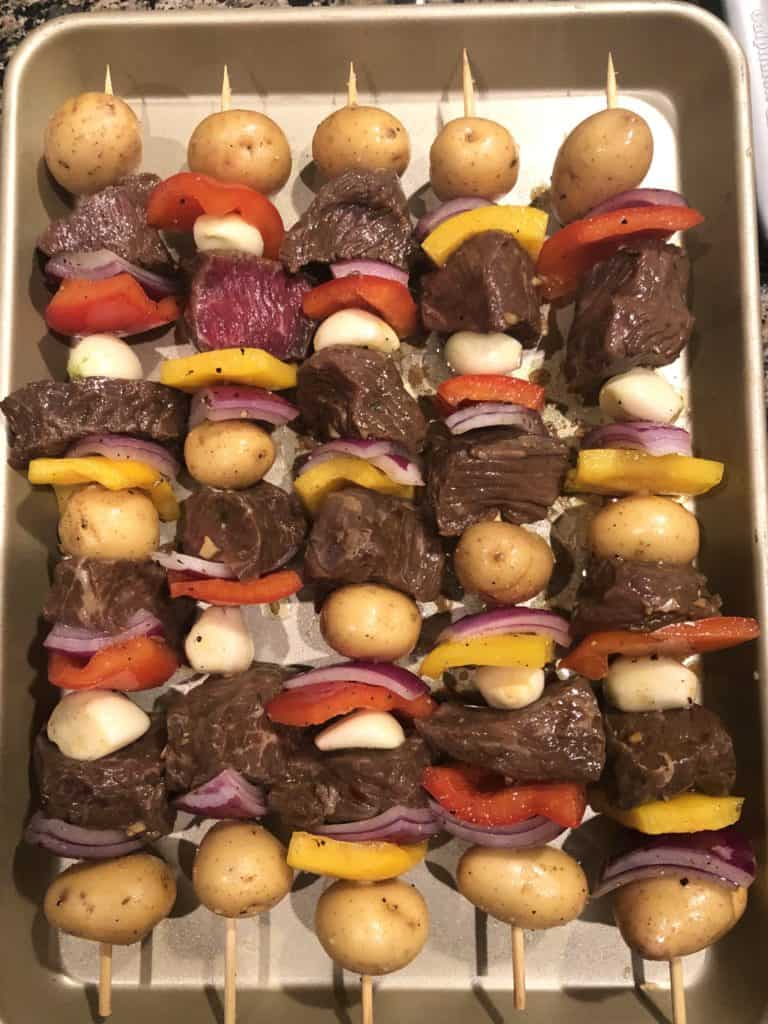 marinated steak skewers on bamboo skewers with vegetables pre grill