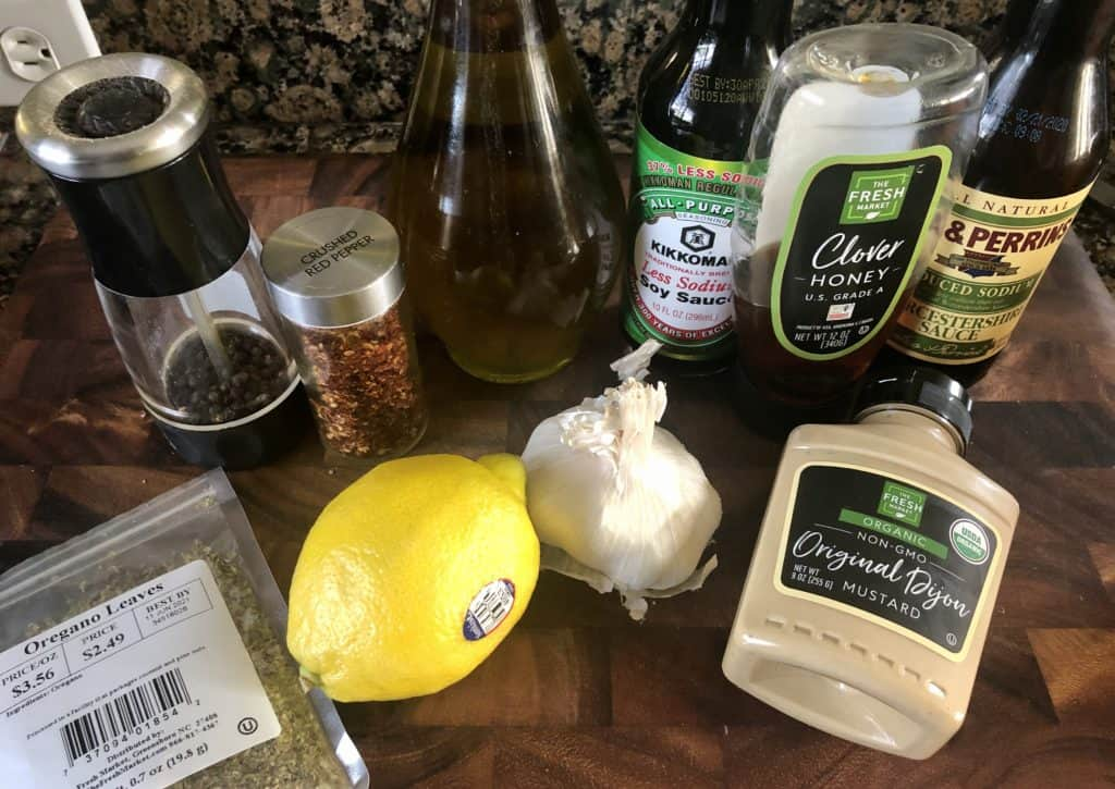 steak marinating ingredients on a cutting board