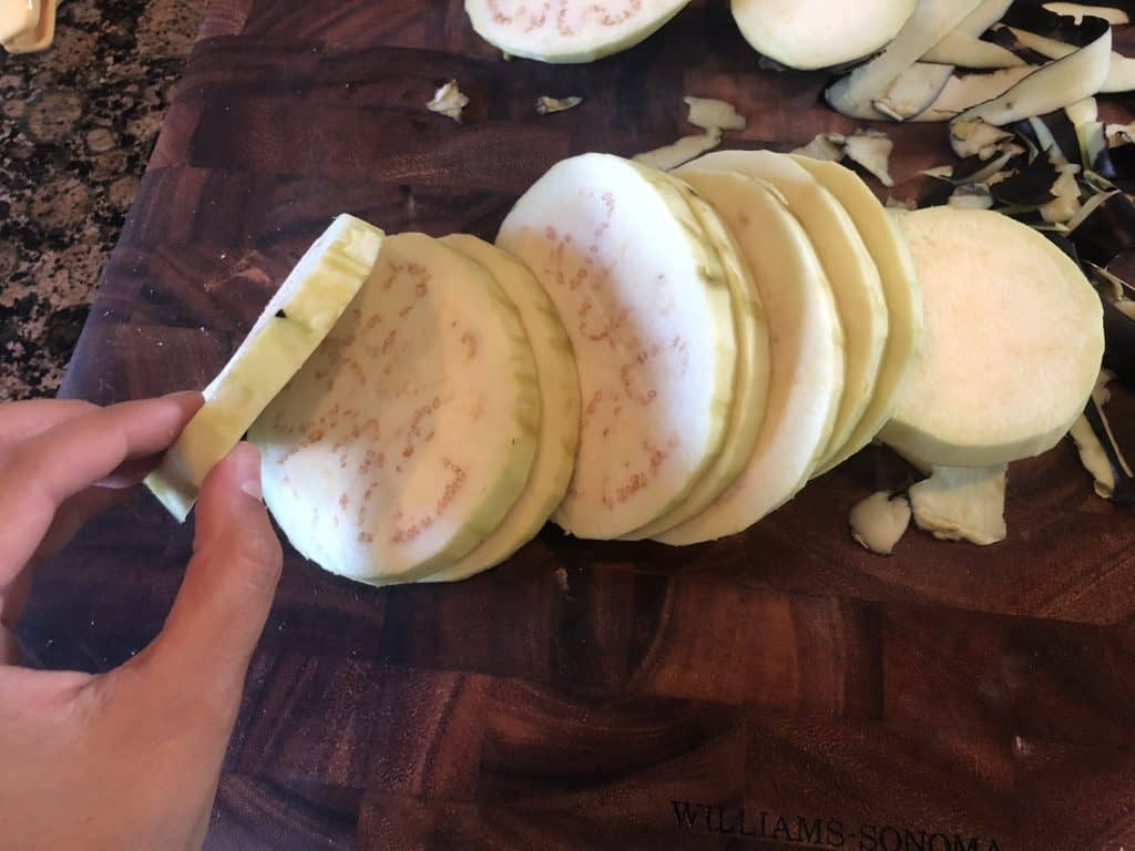 eggplant peeled, and sliced into 1/2 inch slices on a cutting board