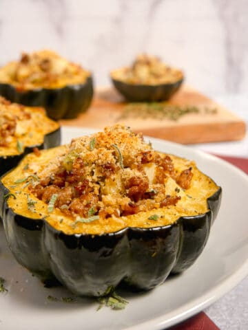 close up of acorn squash stuffed with sausage