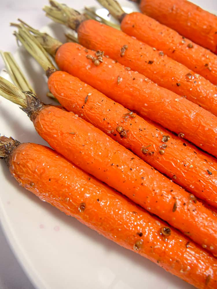 close up of roasted carrots on a plate