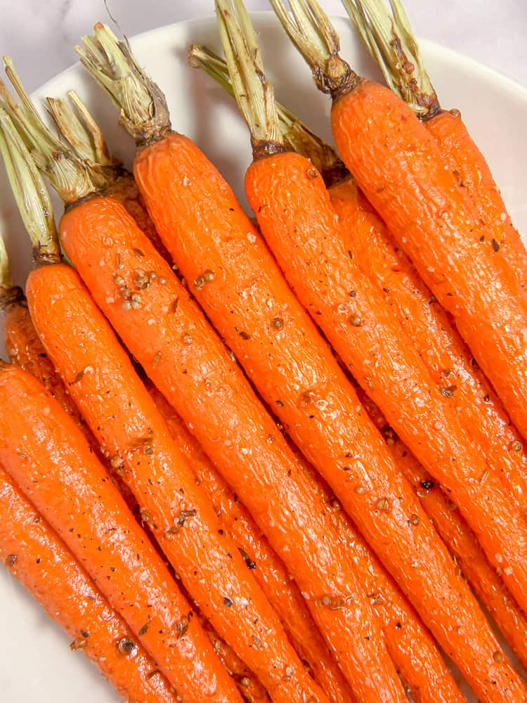 close up of cumin coriander honey roasted carrots on a plate