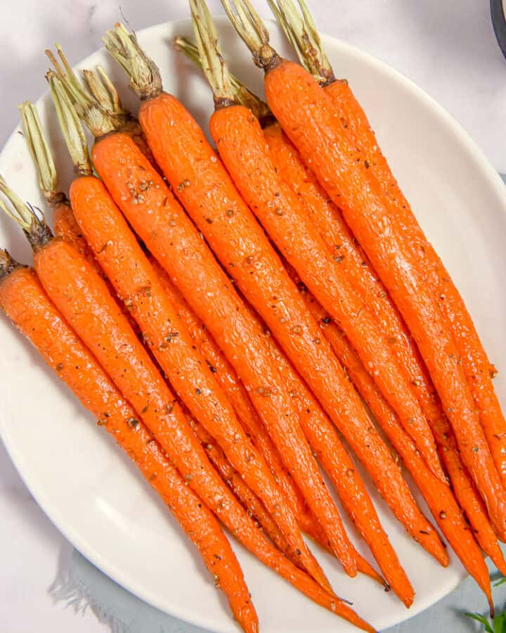 roasted carrots on a white plate