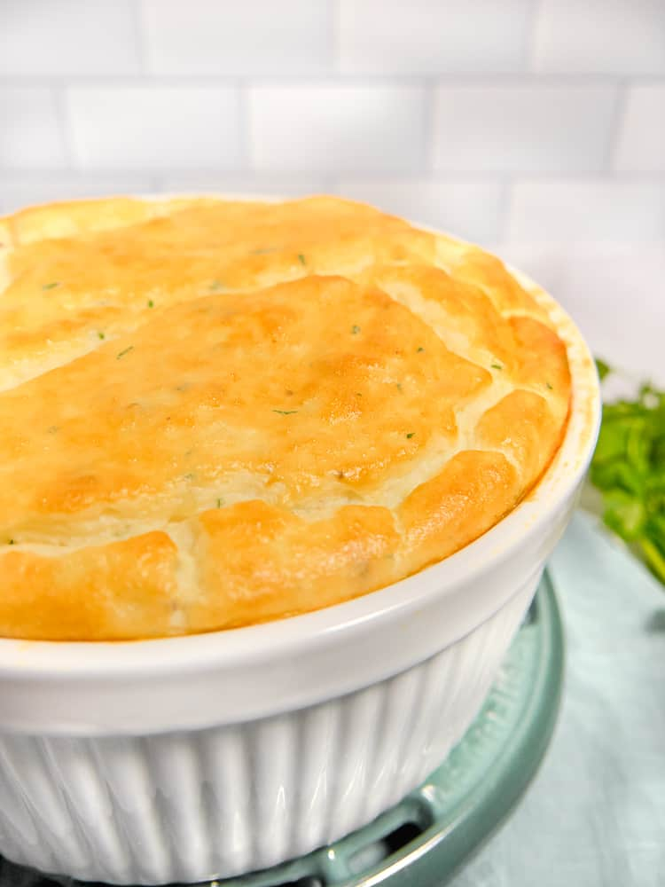 soufflé ramekin with mashed potato soufflé inside with golden brown top