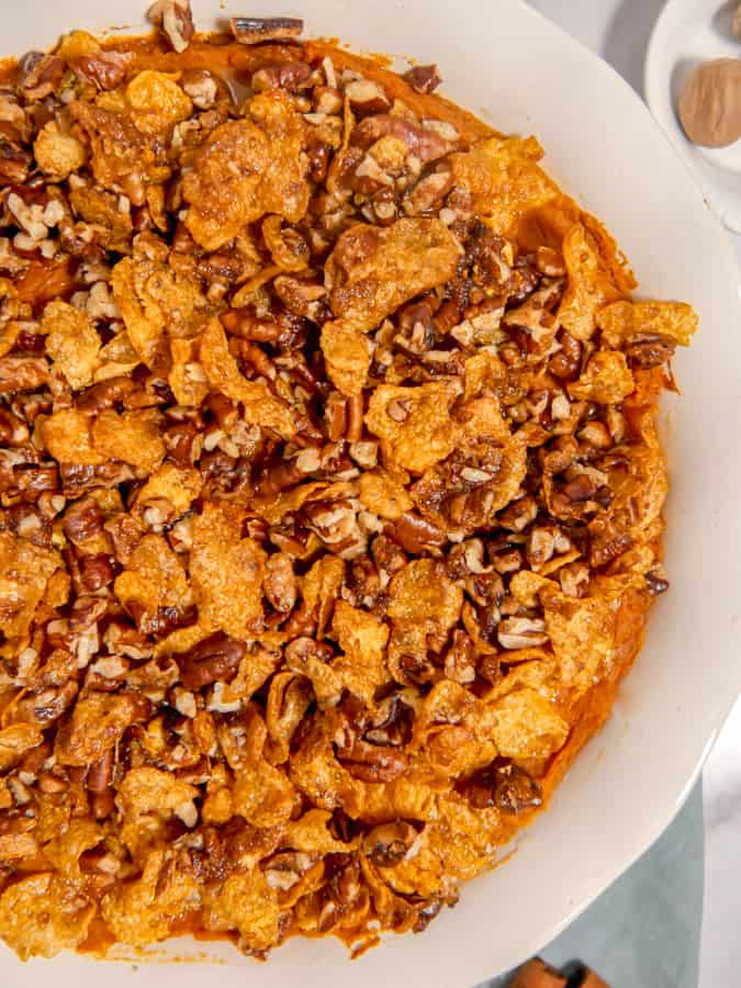 close up of sweet potato casserole with crunchy cornflake topping
