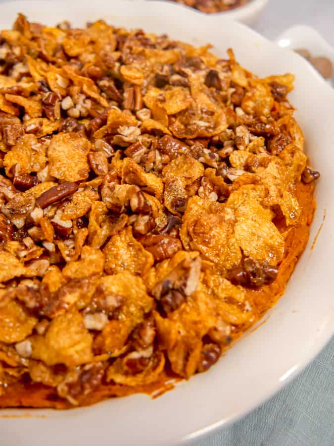 close up of sweet potato casserole with crunchy pecan cornflake topping