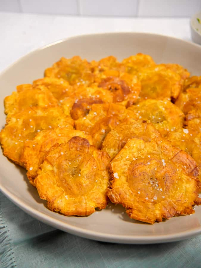 close up of tostones with kosher salt in a bowl