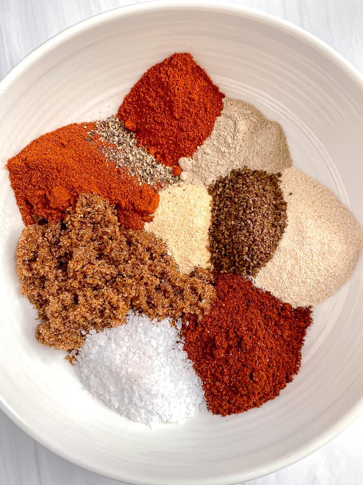bowl with dry rub spices inside: brown sugar, salt, paprika, garlic powder, chili powder, white pepper