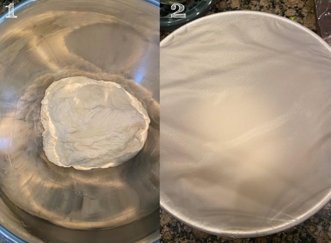ball of dough in a silver bowl