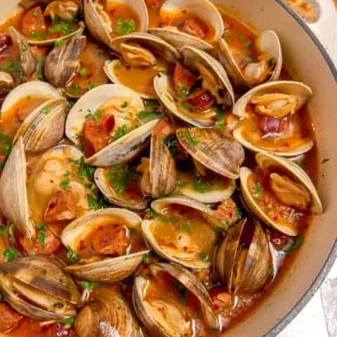 steamed clams in a white wine chorizo broth