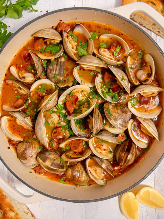 clams and chorizo in a broth topped with fresh parsley
