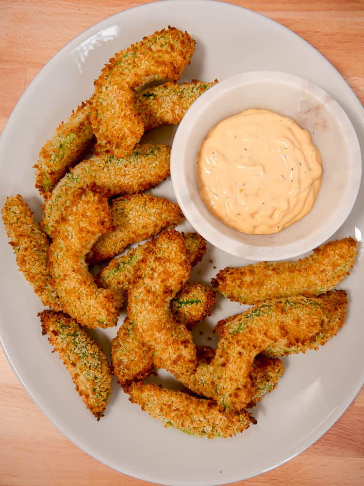 overhead photo of crispy panko avocado fries with dipping sauce
