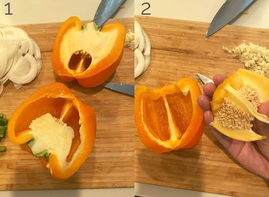 orange bell pepper on a cutting board, cut in half, removing the seeds