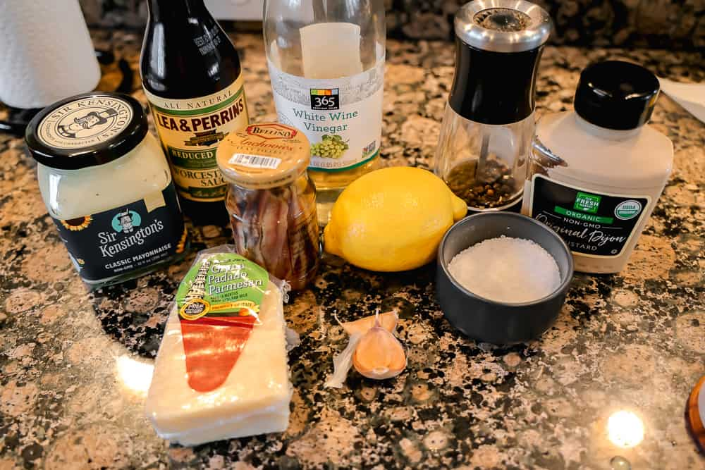 ingredients for homemade caesar dressing on counter