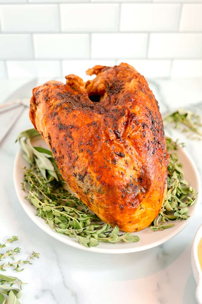 roasted turkey breast on bed of fresh herbs