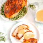 roasted turkey breast with sliced turkey and gravy over the top