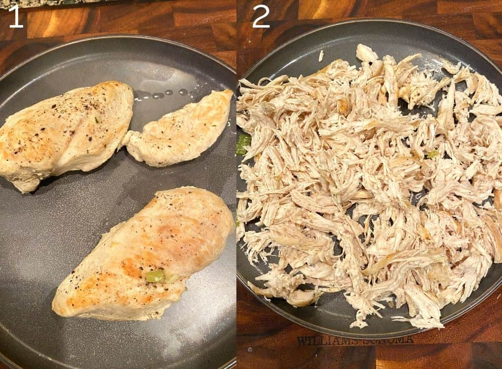 chicken breast on a grey plate being shredded