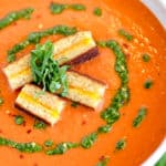 roasted red pepper soup with pistou swirl and grilled cheese croutons