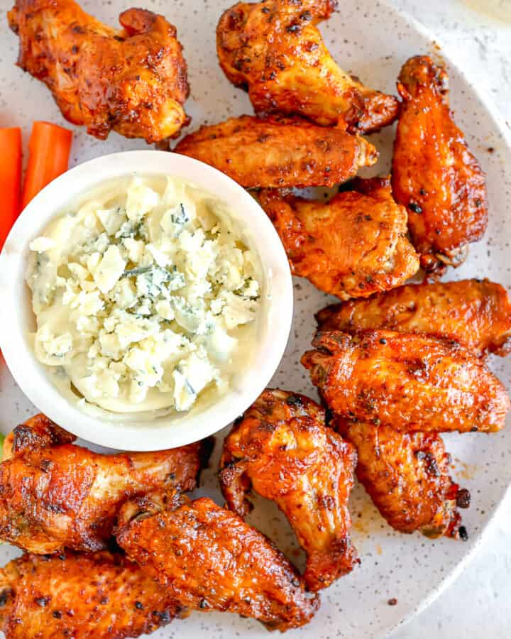 buffalo chicken wings on a plate with blue cheese dipping sauce